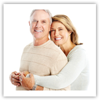 Older couple smiling, isolated