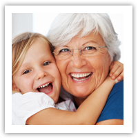 Older woman and kid smiling