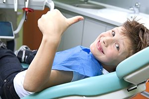 Kid Smiling in a Dental Chair