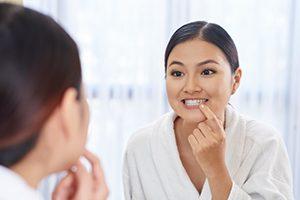 Woman Looking at Her Teeth